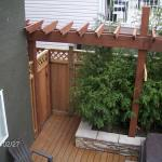 Along with some new fencing this custom privacy pergola was added to create a cozy corner adjacent to the hot tub