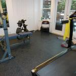 This new gym was added under an existing deck but was completely rebuilt as an addition. The high density custom rubber flooring is made specifically for this use